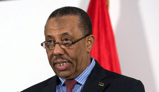 """Libyan PM resigns over """"traitorous"""" armed threat"""
