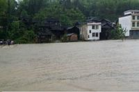 20 dead, 1000s relocated in China rainstorms