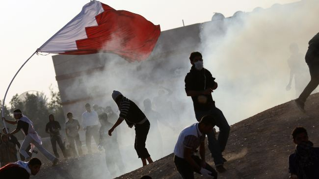 Photo of Bahraini forces attack protesters