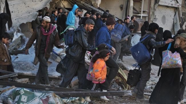 Photo of 100,000 people flee militant infighting in E Syria