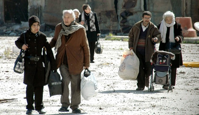 Syria civilians start returning to Homs' Old City