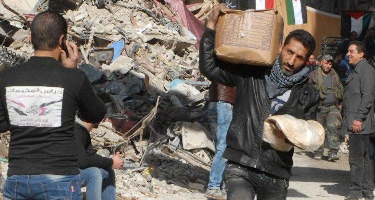 Syrian fighters enjoy feasts while civilians starve
