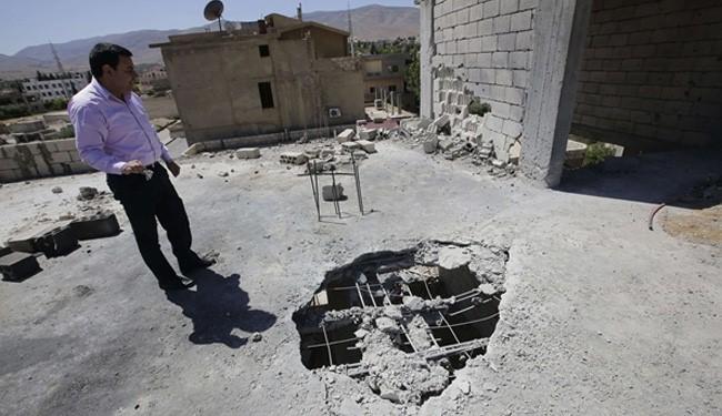 Syria rebel rockets hit Lebanon's Bekaa