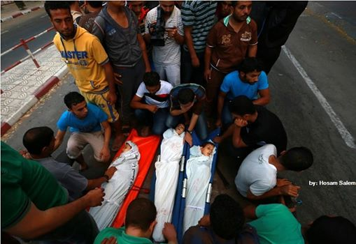 Photo of Boys from Shaibar family, who was killed by Israeli air strike after the end of a five-hour Humanitarian Ceasefire, during their funeral in Gaza City. 18 July 2014