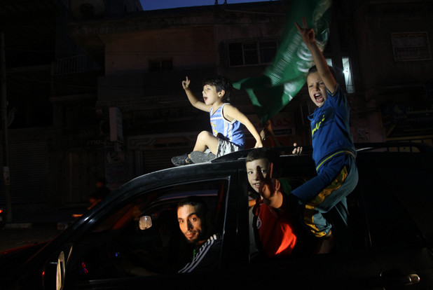 Palestinians gather in the streets celebrating a ceasefire in Gaza