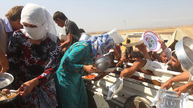 Photo of 15,000 Izadi Kurds find refuge in north Syria