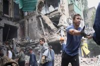 Shelling kills 11 people in Ukraine's Donetsk
