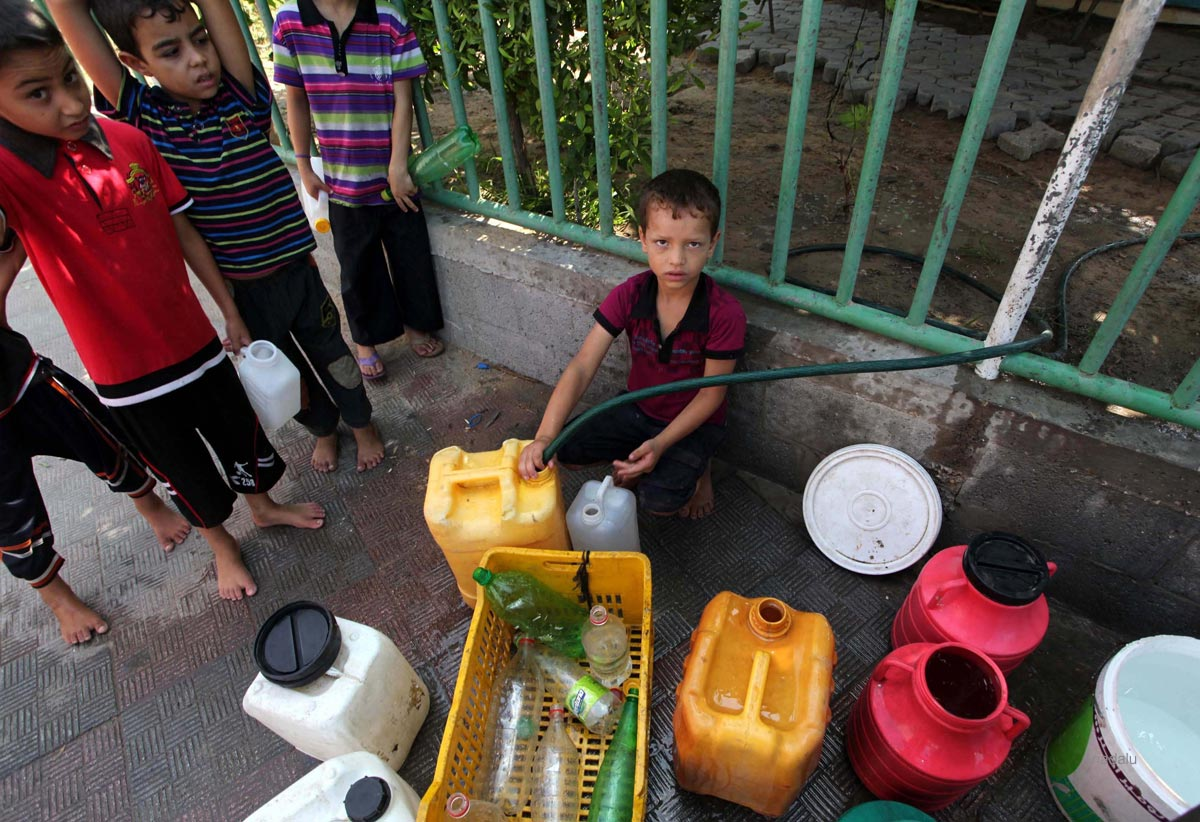 Palestinian children store water