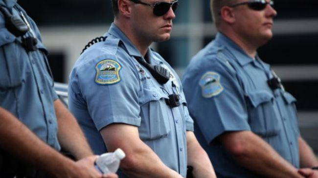 Photo of Ferguson police begin using body cameras