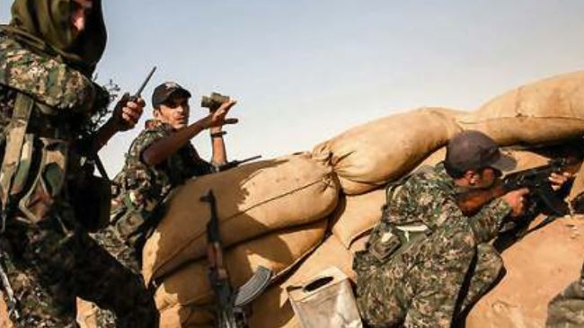 Photo of Kurdish fighters halt ISIL advance in northern Syria