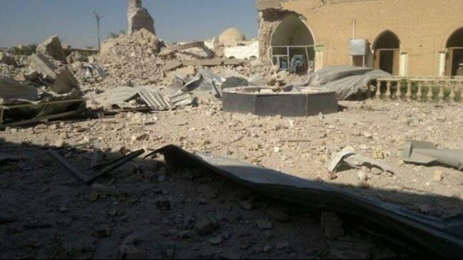 Photo of ISIL terrorists blow up old holy shrine in Iraq's Tikrit
