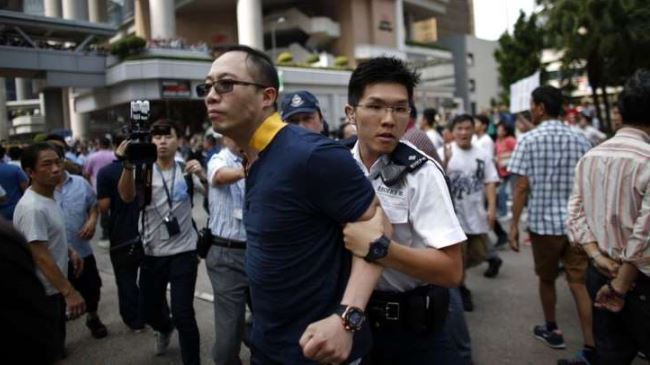 Photo of Fresh clashes rock Hong Kong as 100s break down protest barriers