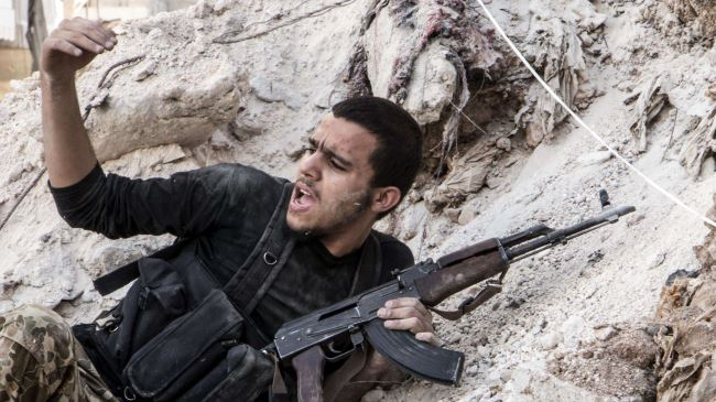 Photo of Qaeda-tied militants beat rivals in NW Syria