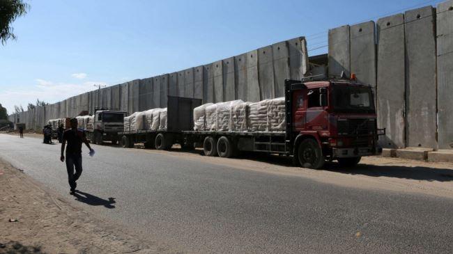 387473_Trucks-cement-Gaza