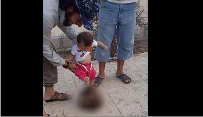 ISIS Terrorist Encourage Baby to Play with Severed Head