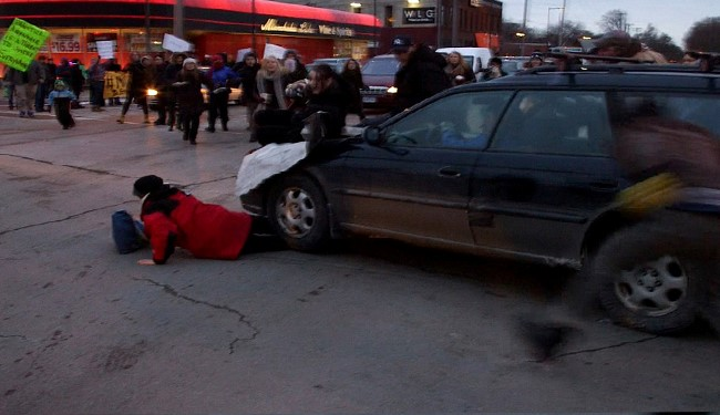 Hit-and-Run Driver Drags Woman 20 Feet Under his FRONT WHEEL in Ferguson Protest