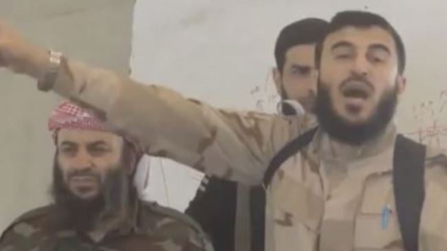 Photo of Militant leader hints at deal with Assad