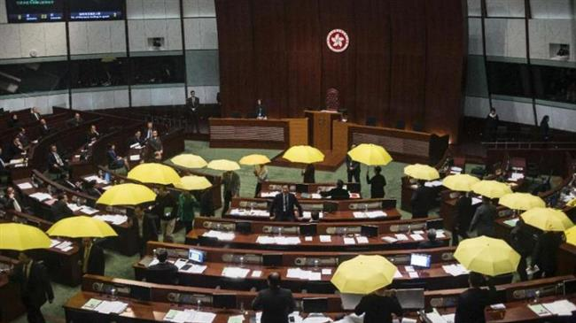Photo of Hong Kong MPs walk out over election law