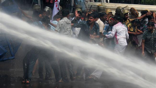 Photo of Protesters clash with police in India's Kerala