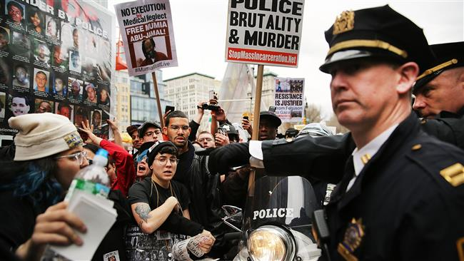 Photo of Dozens arrested in protests against US police violence