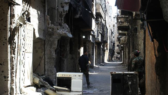 Photo of Palestinian aid workers rap attack on hospital in Syria's Yarmouk