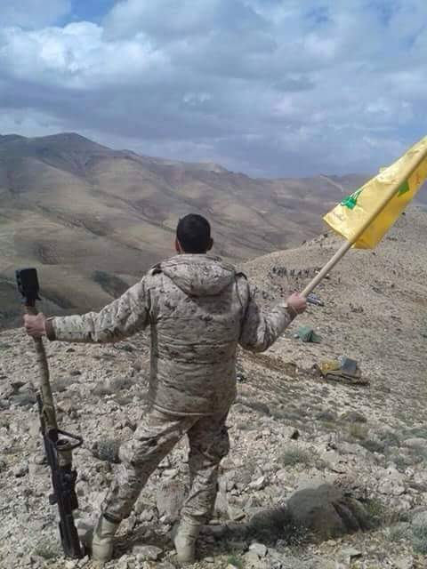 Photo of Directly from the Qalamoon Mountains. Hezbollah raises its flag after a divine victory at respective Kalamoon hills thus clearing the region from terrorist hold.
