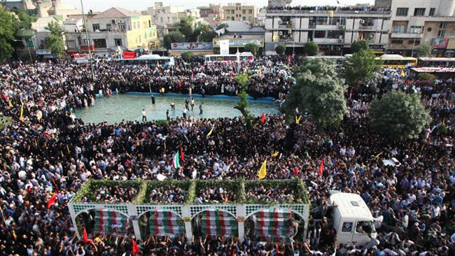 Photo of Iranians attend massive funeral for 270 soldiers martyred in Iran-Iraq war