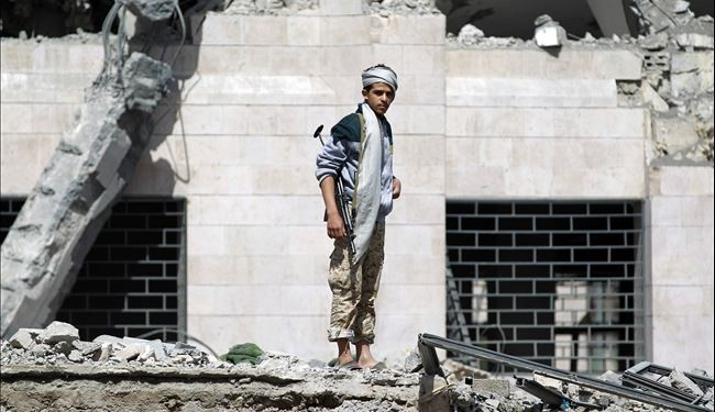 A Huthi Shiite militant inspects what remains of a hotel destroyed in an air-strike by the Saudi-led coalition on May 31, 2015 in Al-Thawra sport city located north of the capital Sanaa. Human Rights Watch published new evidence alleging a Saudi-led coalition is using internationally banned cluster bombs in Yemen, urging it to stop such attacks that were harming civilians. AFP PHOTO