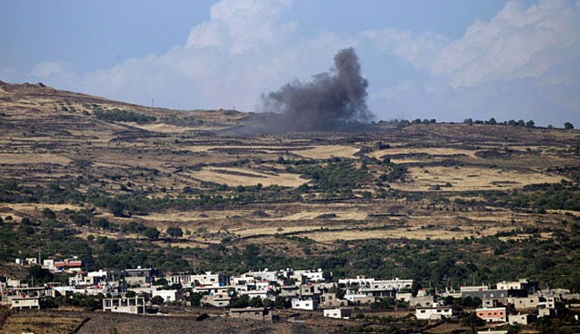 Smoke rises after an explosion in the fighting between Syrian Army and rebels on the outskirts of the Druze village of Khader in Syria, seen from the Israeli occupied Golan Heights AP reports.