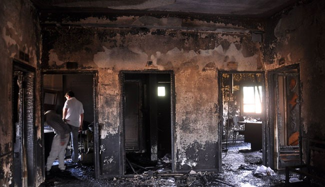 People inspect the damage in the Maysalun clinic where a fire broke out after a fuel tank exploded on May 31, 2015 in the northeastern city of Qamishli --- FILE PHOTO