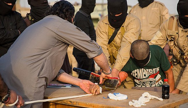 ISIS Butchering a Young Boy in Public