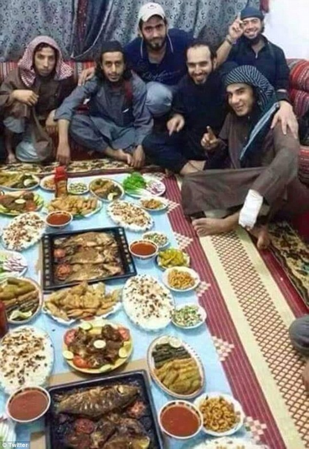 Photo of ISIS Terrorists Celebrate while People Starve