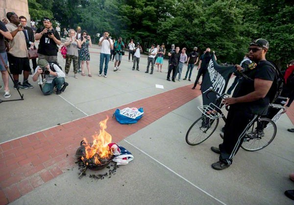 Photo of American Flag Burned in Brooklyn Park to Protest Systematic Racism