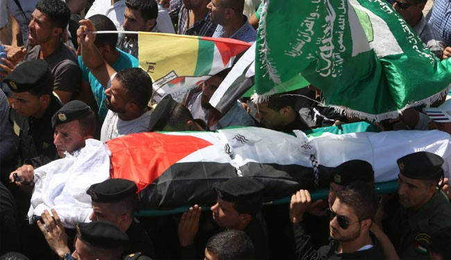 Members of the Palestinian security forces carry the body of Saad Dawabsha, the father of a Palestinian toddler killed last week when their home was firebombed by Jewish extremists, during his funeral in the West Bank village of Duma on August 8, 2015.