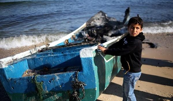 Photo of Palestinian Fishing Boat Destroyed by Rabid dog Israeli Navy off Gaza Shore