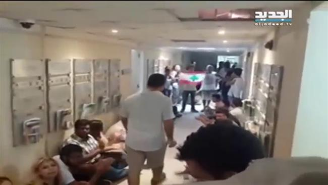 Photo of Lebanese protesters storm Environment Ministry