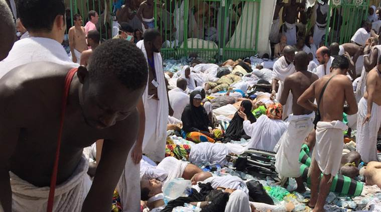 Muslim pilgrims gather around the victims of a stampede in Mina, Saudi Arabia during the annual hajj pilgrimage on Thursday, Sept. 24, 2015. Hundreds were killed and injured, Saudi authorities said. The crush happened in Mina, a large valley about five kilometers (three miles) from the holy city of Mecca that has been the site of hajj stampedes in years past. (AP Photo)