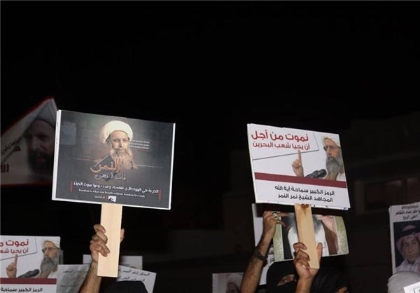 Photo of Photos- Saudi Protesters Warn against Execution of Sheikh Nimr