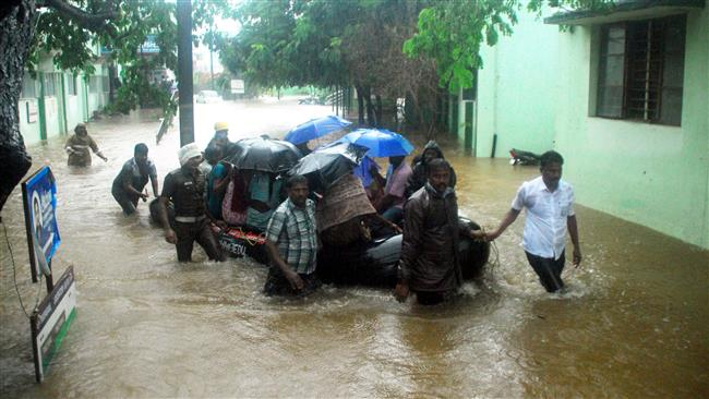 Photo of 1000s flee homes over heavy flooding in India