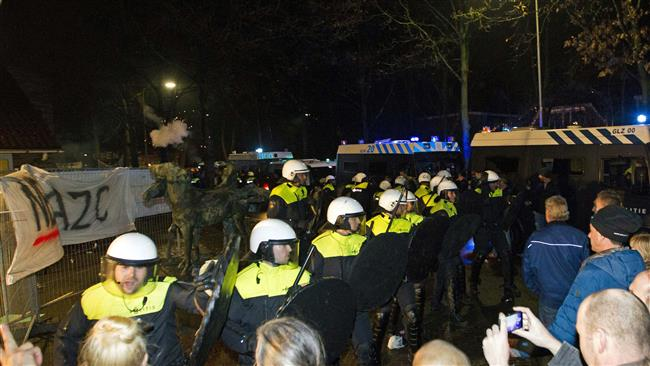 Photo of Police, protesters clash in Netherlands over plan for refugees