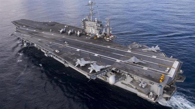 Photo of Iran Navy drone flies over US aircraft carrier in Persian Gulf