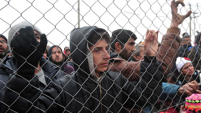 Photo of Pope slams 'rejection of refugees'
