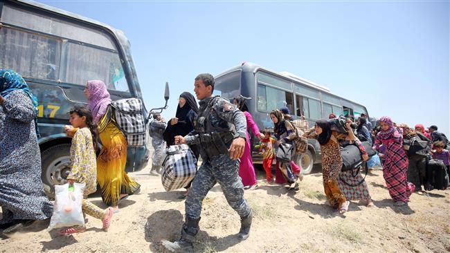 Photo of Iraqi civilians flee Fallujah amid security operation against Daesh
