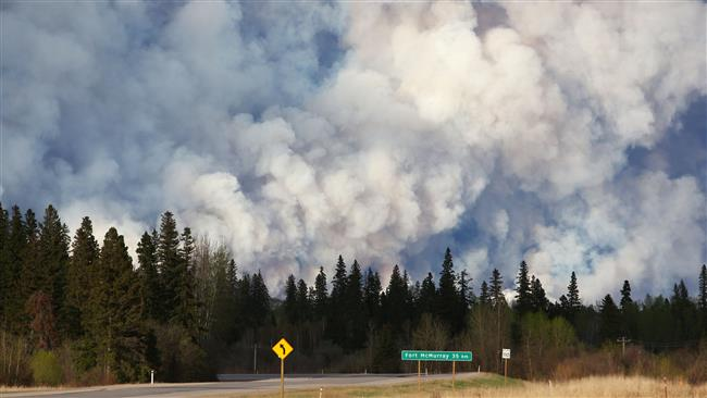 Photo of Massive Alberta wildfire prompts Canada authorities to issue strong warnings