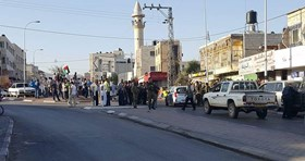 Photo of Palestinians confront zionist settlers guarded by israeli forces in Huwara town