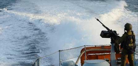 Photo of IOF open fire toward Palestinian fishing boats, citizens' homes