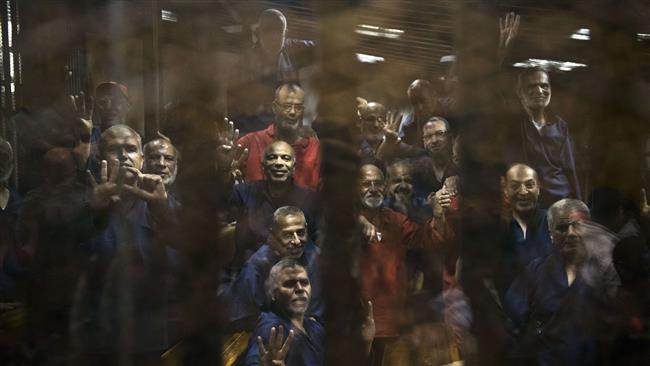 Photo of Egypt court sentences 187 Morsi supporters to life in prison