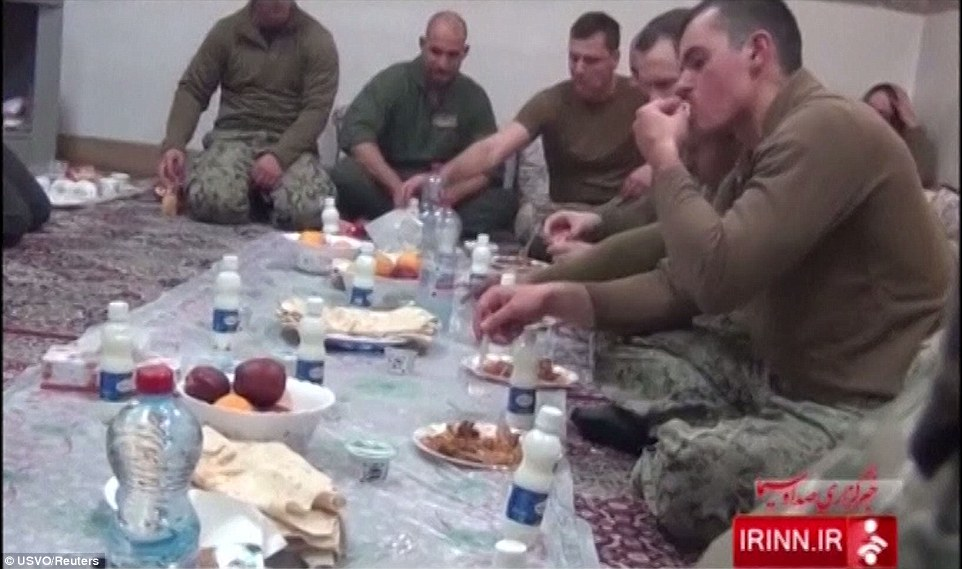 3022827000000578-3397254-A_group_of_the_sailors_are_seen_enjoying_food_they_were_given_du-a-27_1452712261483