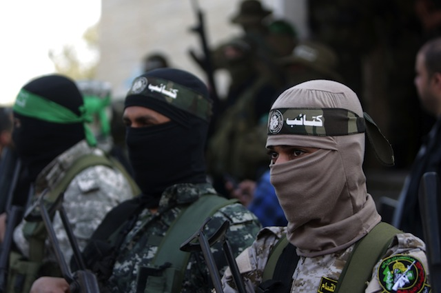 Palestinian members of the Ezzedine al-Qassam Brigades, the armed wing of the Hamas movement mourn during the funeral of fellow militant Ahmed al-Zahar in the village of Al-Moghraga near the Nuseirat refugee camp in the central Gaza Strip on  February 3, 2016. The collapse of a tunnel in the Gaza Strip has killed two militants from Hamas's armed wing, officials said Wednesday, as concern grows in Israel over the rebuilding of tunnels that can be used for attacks.  / AFP / MAHMUD HAMS        (Photo credit should read MAHMUD HAMS/AFP/Getty Images)