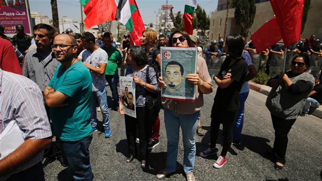 Photo of Palestinians march against world silence on hunger striking prisoner